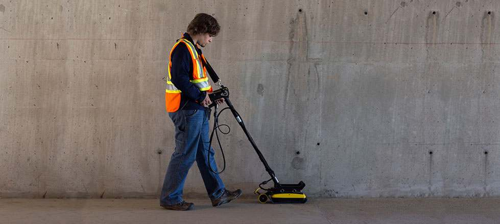 Person on a parking lot using the Noggin 1000 GPR