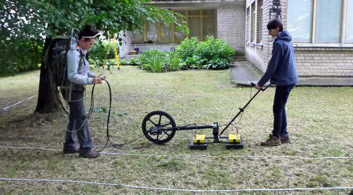 two people using GPR smart tow for ground scanning