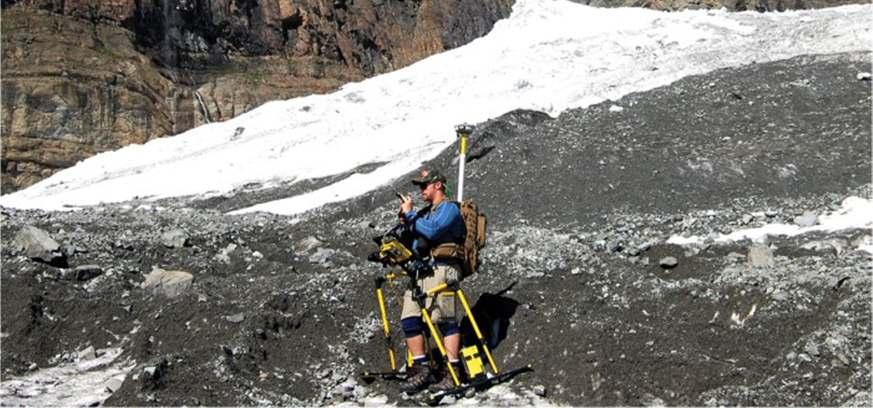 man using pulseekko gpr in mountains